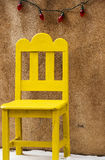 Yellow Chair. A little yellow chair and holiday decorations Royalty Free Stock Images