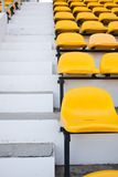 Yellow chair near the pavement. Seat grandstand yellow watch the games inside the stadium Royalty Free Stock Images