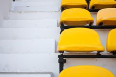Yellow chair near the pavement. Seat grandstand yellow watch the games inside the stadium Stock Photography