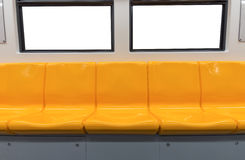 Yellow chair and windows in electric train Royalty Free Stock Image