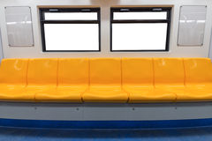 Yellow chair and windows in electric train Stock Image