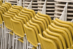 Yellow Chairs. Stacked Chairs and tables Royalty Free Stock Photography