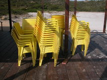 Yellow chairs. Arranged at the end of the summer season Stock Images