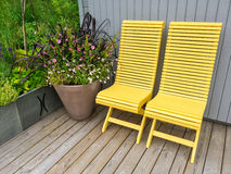 Yellow chairs and flowers decorating house exterior Royalty Free Stock Photo