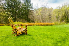 Yellow chairs with giraffe spots. In the garden surrounded by greenery Stock Photo