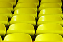 Yellow chairs in rows Royalty Free Stock Photography