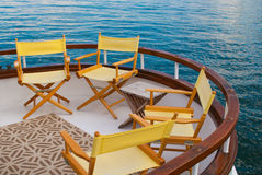 Yellow Chairs on a Sailboat Deck. Four Yellow Chairs on a Sailboat Deck Royalty Free Stock Images