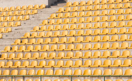 Yellow chairs on the soccer field. Many yellow empty chairs on the soccer field Royalty Free Stock Photos