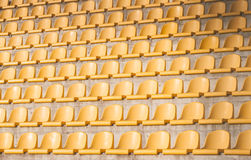 Yellow chairs on the soccer field. Many yellow empty chairs on the soccer field Royalty Free Stock Images