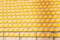 Yellow chairs on the soccer field Royalty Free Stock Photos