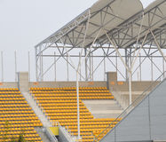 Yellow chairs and stadium Stock Images