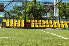 Yellow chairs in statdium. Row of yellow chairs in football stadium Stock Images
