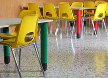 Yellow chairs and tables in the kindergarten Royalty Free Stock Photo