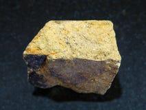Yellow Chalcopyrite stone on dark background Royalty Free Stock Image