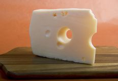 Yellow cheese. Piece of Yellow cheese with holes stock images