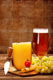 Yellow cheese appetizer and beer Royalty Free Stock Photo