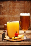 Yellow cheese appetizer and beer Royalty Free Stock Images
