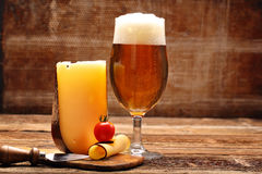 Yellow cheese appetizer and beer Royalty Free Stock Photos