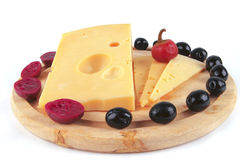 Yellow cheese block on plate Stock Image