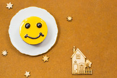 Yellow cheese cake with brown eyes. Icons stars and house. Royalty Free Stock Images