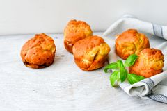 Yellow Cheese and cheese   muffins. Breakfast  from   organic  bio  yellow cheese, home made cheese   muffins  and fresh basil   on a  white wooden background Stock Photo