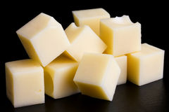 Yellow cheese cubes. Stock Photography