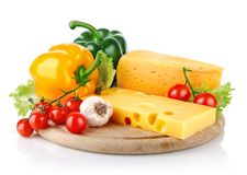 Yellow cheese with fresh vegetables Royalty Free Stock Images