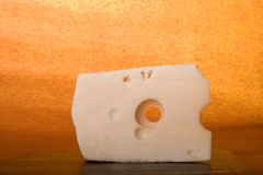 Yellow cheese with holes Stock Images