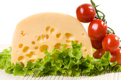 Yellow cheese and red tomato Stock Photography