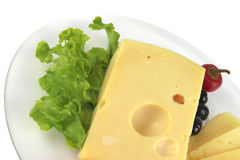 Yellow cheese served on dish Stock Photography