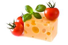 Yellow cheese with tomatoes Royalty Free Stock Image