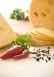 Yellow cheese and vegetables Stock Photography