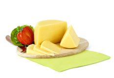 Yellow cheese on a wooden plate Stock Photography
