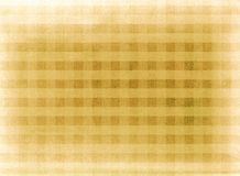 Yellow chequered fabric background Royalty Free Stock Images