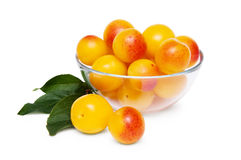 Yellow cherry plum. Glass bowl of the yellow damson plum isolated on a white background Royalty Free Stock Images