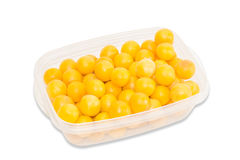 Yellow cherry plum in plastic tray on a light background Royalty Free Stock Photo