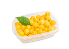 Yellow cherry plum in plastic tray on a light background Royalty Free Stock Image