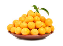 Yellow cherry plum on the plate Royalty Free Stock Image