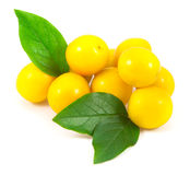 Yellow cherry plums with leaves. On white background Stock Photo