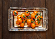 Yellow cherry tomatoes on a metal tray Royalty Free Stock Photography