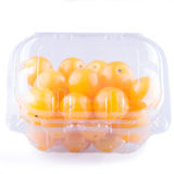 Yellow cherry tomatoes. Packaged for sale. white background Stock Image