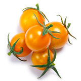 Yellow cherry tomatoes, pile,  top view, paths Royalty Free Stock Images
