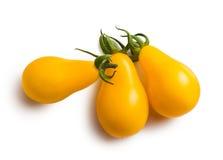 Yellow cherry tomatoes. On white background Royalty Free Stock Photo
