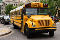 Yellow Chicago school bus turning a corner Royalty Free Stock Image