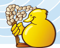 Yellow chick with catkins Stock Image