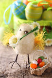 Yellow chicken and easter eggs Stock Photography