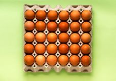 Yellow chicken eggs in a cardboard box Royalty Free Stock Photos