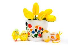 Yellow chicken with eggs and tulips Royalty Free Stock Photography