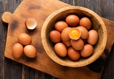 Yellow chicken eggs in a wooden bowl Royalty Free Stock Photo