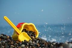 Yellow children's bucket with scoop Stock Images